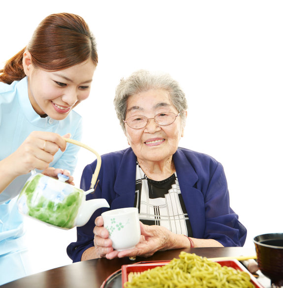 caregiver pouring water to patient's cup